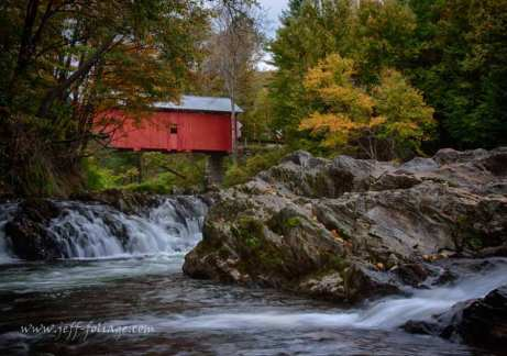 The fall colors are developing around the the Slaughterhouse covered bridge