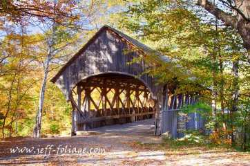 The end view of the Sunday River Covered Bridge with Maine fall foliage