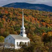 Towering white steeple into fall colors