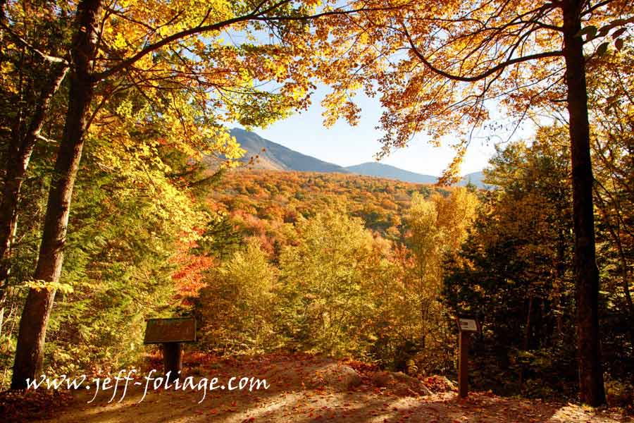 View off the trail of the nearby mountains with all the hillsides covered in fall foliage