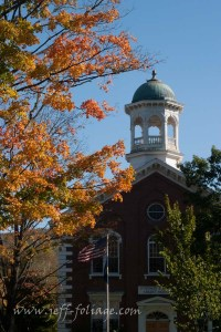 Weather green copper cupola on the top of the courthouse awaiting peak fall foliage in Woodstock