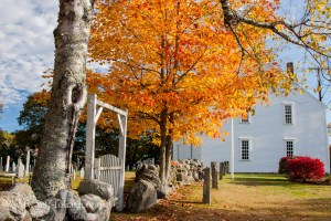 Orange fall colors around meeting house and cemetery