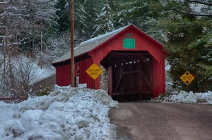the lower falls covered bridge is a red single lane covered bridge