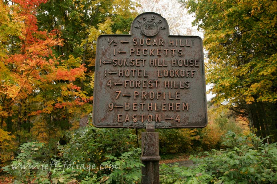 Road sign in the New Hampshire fall foliage showing the scenic drives of Sugar Hill NH