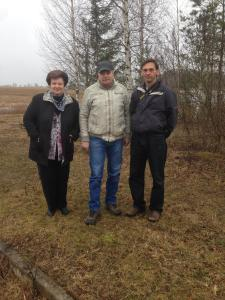 My brother Paul, cousins Janis and Mara standing on the land Vitauts grew up on.