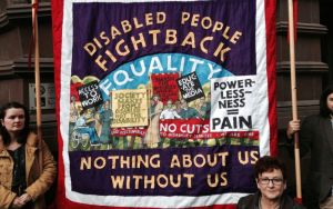 "A protest banner that reads ""Disabled people fight back! Nothing about us without us"""