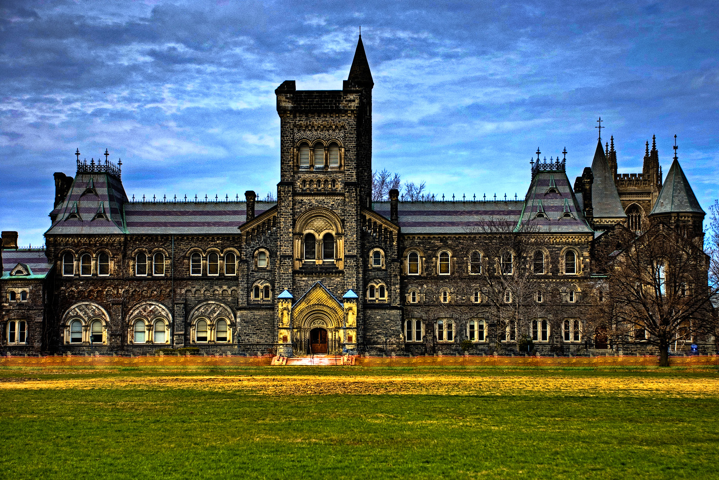 High contrast image of University College building at the University of Toronto at dusk