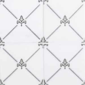 A white natural stone decorative element french chateau tile by Jeffrey Court.