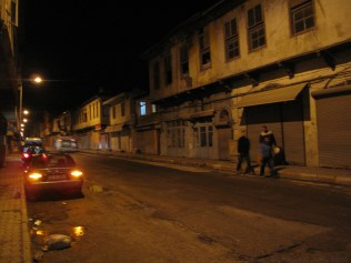 Walking at night in Antakya. THe street had a movie set like feeling from the yellow, flat streetlights.