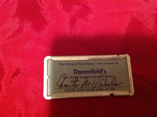 """From former Customer and blog reader Anita Varela. """"I was cleaning out my storage when I came across my little charge plate. Many good memories of Donenfeld's and downtown Dayton. My children liked to ride on the elevator because it had a live operator. I still have my fur coat that I saved for a year to get. It's sad to see how that part of town looks now and the arcade all closed up."""" Thanks Anita for pics of this Donenfeld's Charg-A-Plate Token!"""