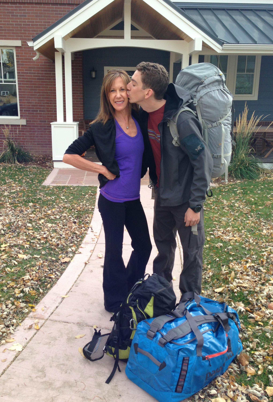 Kissing mom goodbye at home in Boulder, Colorado, USA. November 8th, 2012