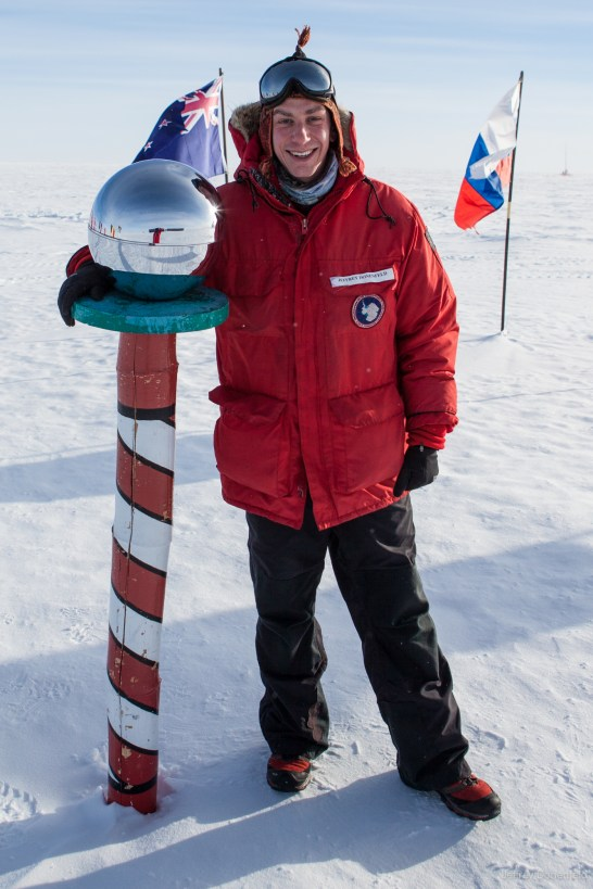Ceremonial South Pole, with my United States Antarctic Program - issued ECW Jacket. It has a patch with my name on it, and a USAP logo patch.