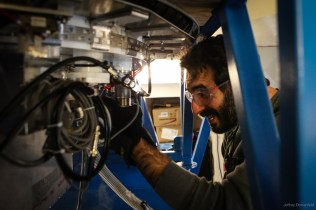 Physicist Jon Kaufman fueling the Bicep2 Telescope with liquid helium.