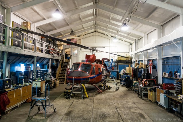 Inside the McMurdo helicopter hanger, a Bell 212 sits for maintenance.