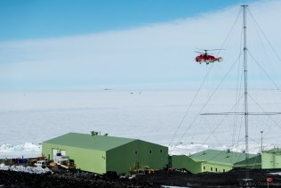A Chinese-Operated Kamov KA-32 Helicopter hovers over New Zealand's Scott Base.