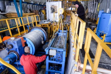 Rigging the levelwind for extraction from the winch pit. Each piece of gear was meticulously secured to be moved carefully.