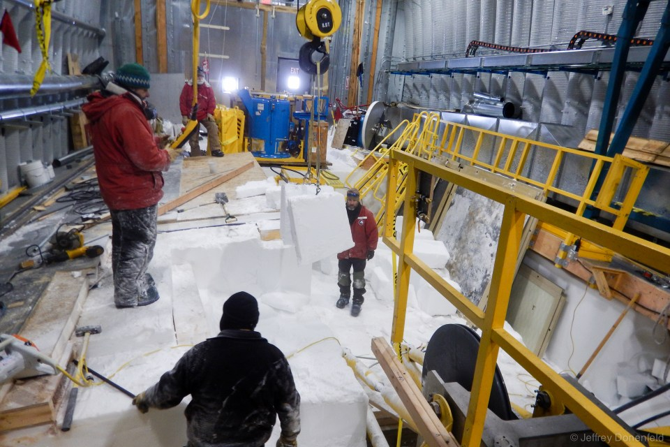 Moving large blocks of ice out of the way, in order to extract the heavy tower base feet, which were embedded in the ice under the floor.