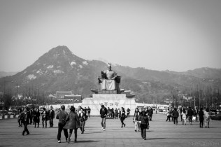 The statue of King Sejong, sitting outside of the seoul palace.