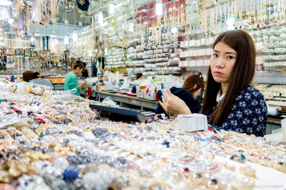 At the Seoul Namdaemun Market, vendors occupy booths packed with every variety of jewlery, house goods, clothing, toys, and anything else you need.