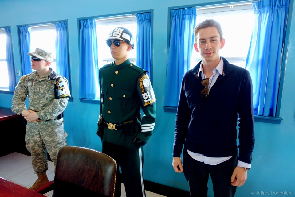 Inside the meeting room on the MDL Military Demarcation Line, the border officially separating North Korea from South Korea. In this photo I'm physically within the North Korean border, however the entire space of the room is considered a neutral zone, so I'm not officially in either Korea. Next to me is a north korea border guard. Interestingly, during my return visit to this exact room a few weeks later, coming from the North side, the North Korean guards were dressed completely differently, in more standard military outfits, and were much more relaxed and personable. They only put on this steely dress and demeanor when tours from the south are present. Photos of this exact room while i was on my tour of North Korea are coming soon. I would also sit in the seat pictured here during my subsequent tour from the north.