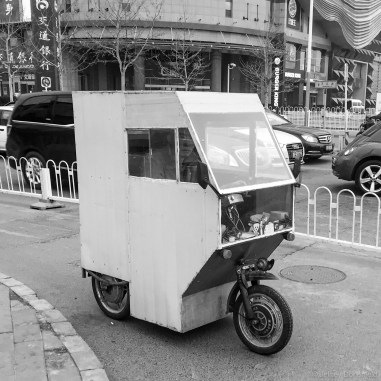 "I love these rickshaw mopeds. They come in lots of varieties, ranging from crappy home-made ones like this, to pre-manufactured slick metal ones that resemble am airstream trailer. A friend of mine and I play an iOS game called ""Pako"", and this one looks exactly like the one that can be driven in that game. Cool!"