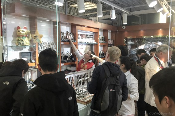 Checking out fake watches at the Beijing Silk Market. This market caters mostly to Tourists, and has floors packed with knockoff clothing, jewlery, electronics, and textiles. Most of these watches they have on display are low-mid range fakes, but they're quick to bring out briefcases of high-end fakes on request.