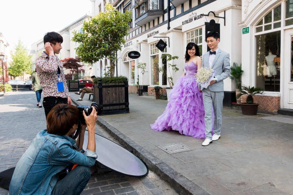 Couples taking wedding engagement photos are everywhere in Thames Town, a Chinese copy of a traditional British town.