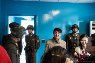 This photo is of the North Korean guards inside one of the blue buildings. I had been in this exact room a few weeks prior, and in addition to the South Korean guards, there were also North Korean guards. However, the tone was completely different from the Northern guards. When I visited from the south, the North Korean guards wore completely different uniforms, with large korean letters on their helmets, imposing dark RayBan sunglasses, and an extremely stern, tense pose. This time, the guards were upbeat and friendly, and there was no sign of any guards from the south.