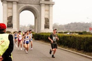 Here I am coming around a corner during my run of the 2015 Pyongyang Marathon. Both tourists and professional Korean athletes ran at the same time - so the entire time I was running, I was being passed by the pros!