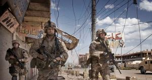 Inside Iraq RAMADI, IRAQ-APRIL 27, 2006: U.S. Marines from the 3rd Battalion, 8th Marine Regiment, Kilo company scan streets and surrounding buildings for insurgents during a patrol in Ramadi, 115 kilometers (70 miles) west of Baghdad.