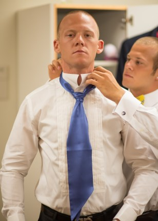Groom Cory getting suited up
