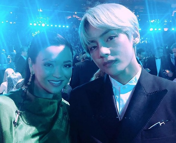 v of bts and serena mckinney goransson wife of grammy winner ludwig pose for an iconic photo online inquirer v of bts and serena mckinney goransson