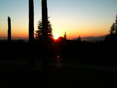 The sun dropping below the horizon