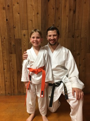 Receiving his orange belt