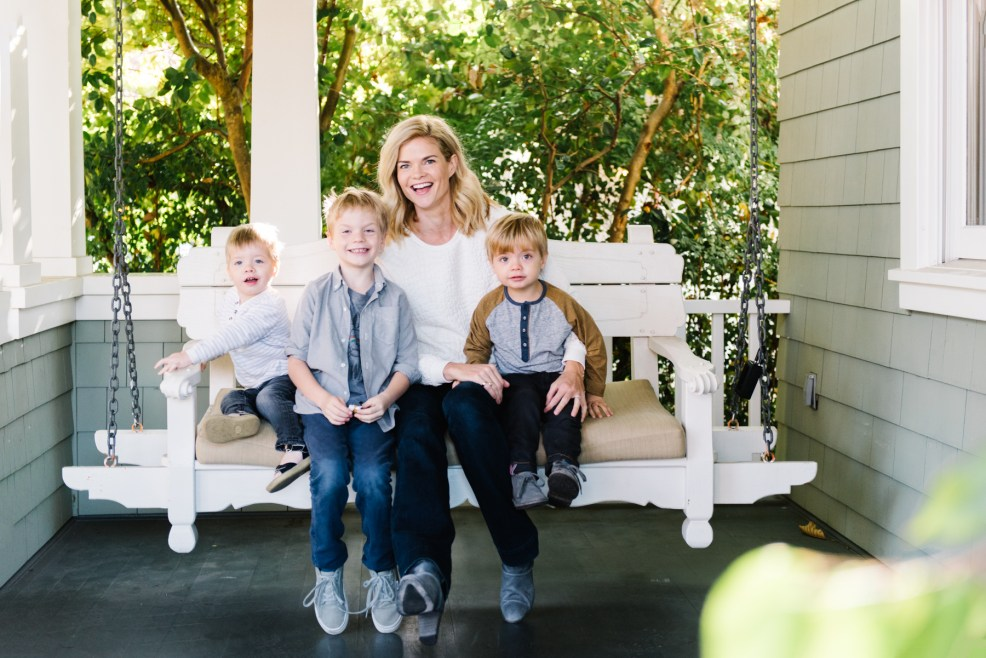 mom and boys on porch swing