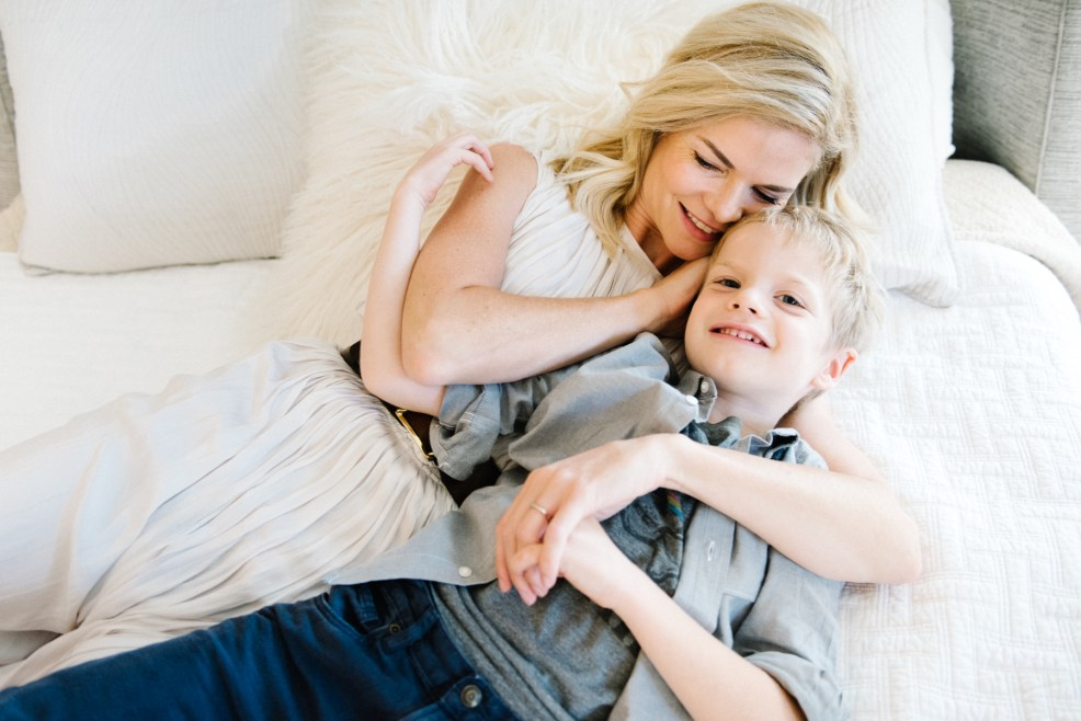 mom cuddling her little boy