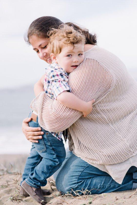 Mother hugging toddler son