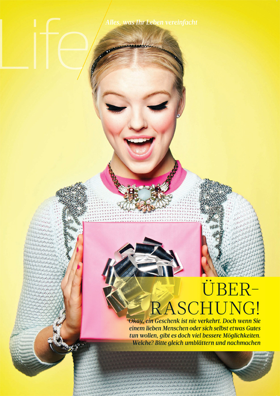 Girl holding a box with a bow in Women's Health Germany