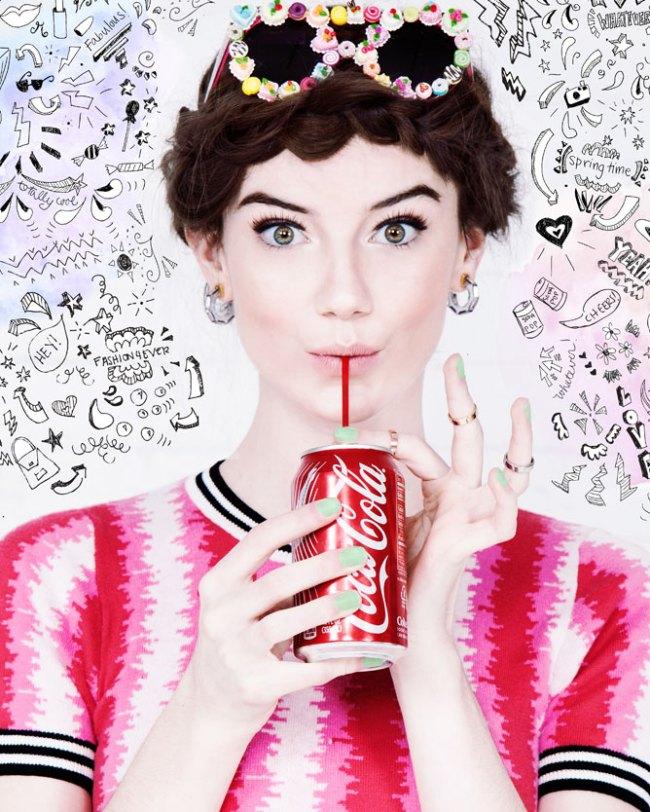 Girl drinking a coca cola