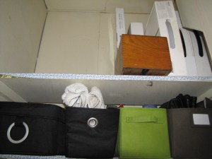 Tall closet showing containers