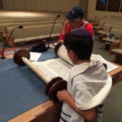 Practicing his Torah reading