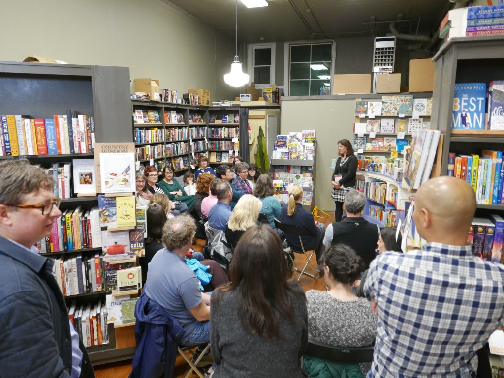 Reading to the crowd at Phinney Books