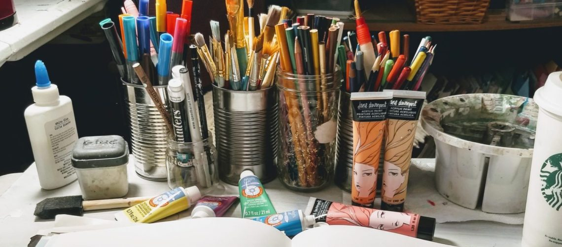What You Need to Start an Art Journal, colored pencils in jars, paint pens, neon paints, flesh colored acrylics,