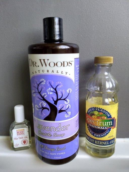ingredients for liquid hand soap. liquid castile soap, apricot kernel oil, tea tree oil. diy liquid hand soap