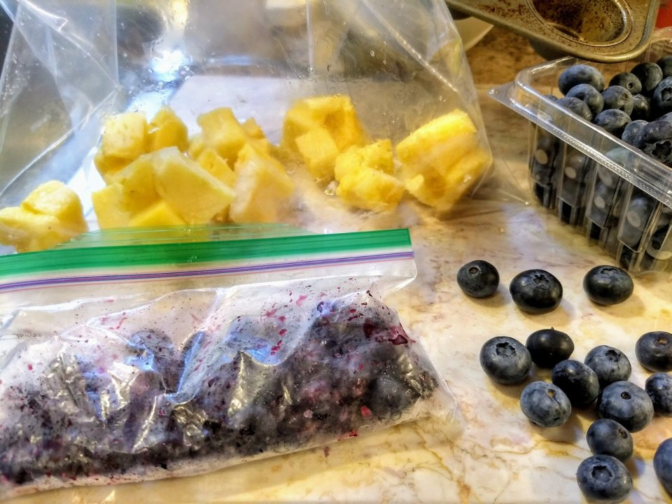 Freezing fresh blueberries and pineapple