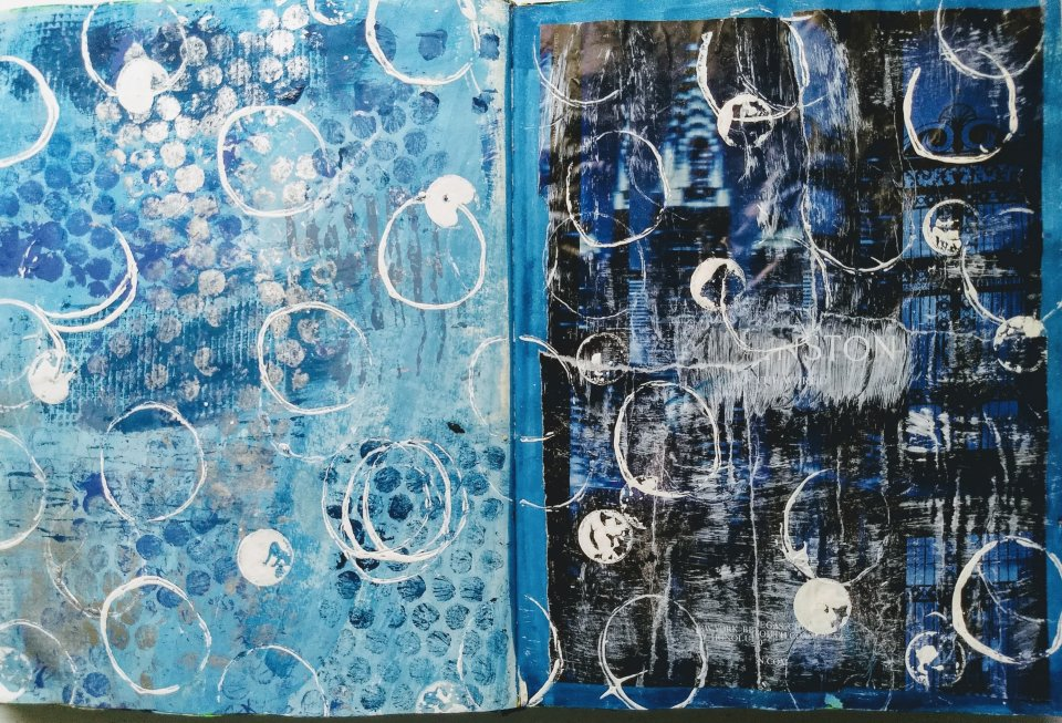 "White paint ""bubbles"" on bubble wrap printed blue background, art journal page."