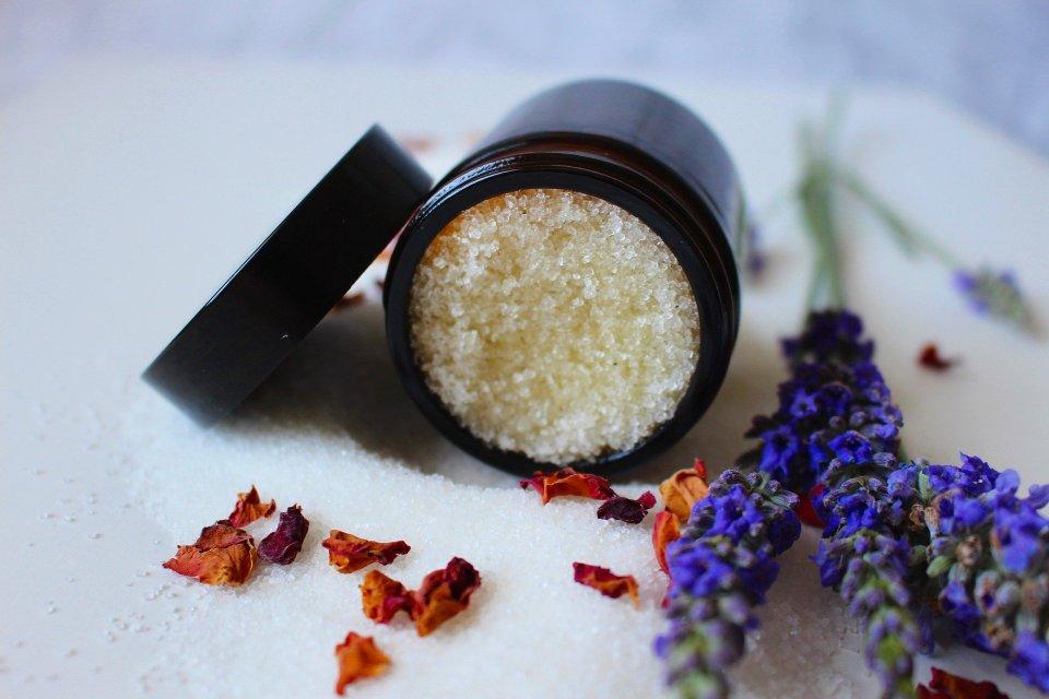 Jar of sugar scrub, open, dried flowers, How to Make An Exfoliating Sugar Scrub