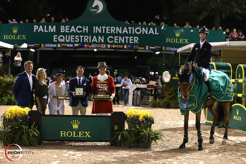 Ben Maher and Sarena in their winning presentation with Equestrian Sport Productions CEO Mark Bellissimo; Wellington Equestrian Partners Principal Katherine Bellissimo; Marsha Dammerman; Joel Aeschlimann, Head of Sponsorship, Rolex; and ringmaster Christian Craig.