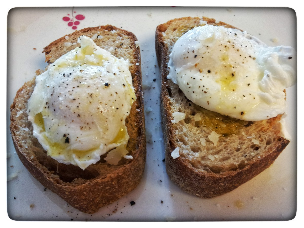 Picture of two poached eggs on thick toast, sprinkled with parmesan.