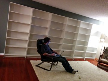 We don't have furniture, but the first thing we do is build our library.